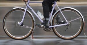 A road bicycle with full-coverage fenders for protection from road spray