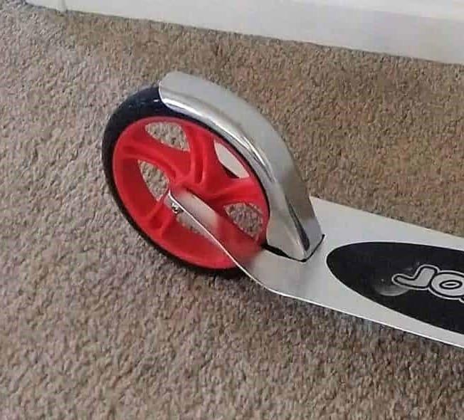 "Rear fender brake (""stomp brake"") on a Razor A5 Lux Scooter"